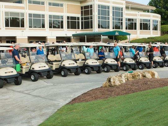 Golfers prepare to participate in annual Wildcat Gives Back to Community tournament.