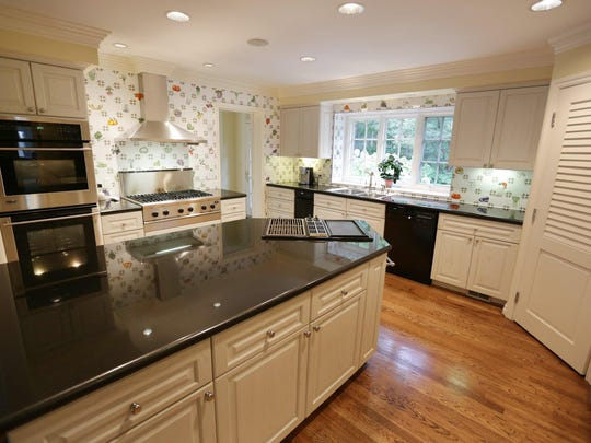 The kitchen is spacious and has a pantry.