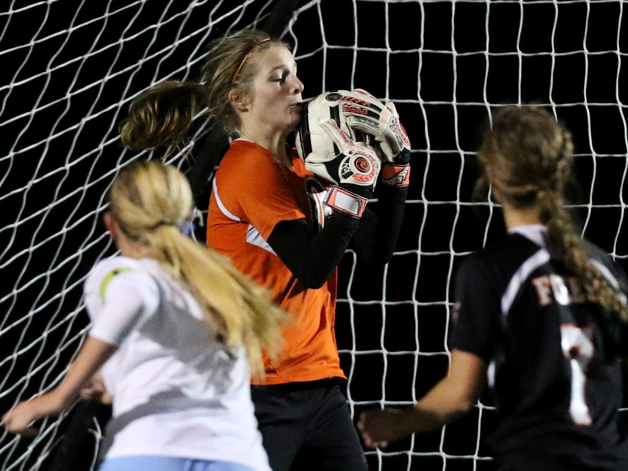Silverton's Kylie Lulich (0) makes a save in the Silverton vs. Corvallis girl's soccer Mid-Willamette Conference championship game at Corvallis High School on Tuesday, Oct. 27, 2015. Corvallis won the championship 2-1.