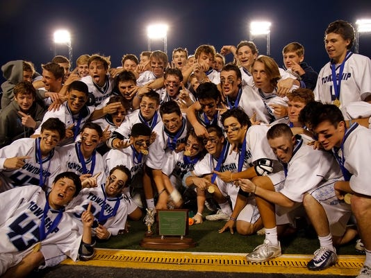 Manheim Township poses with their trophy after winning the District 3 boys' lacrosse championship game at Hersheypark Stadium in Hershey on Thursday, May 21, 2015. The Blue Streaks, 8-3 Kirk Neidermyer for GameTimePA.com