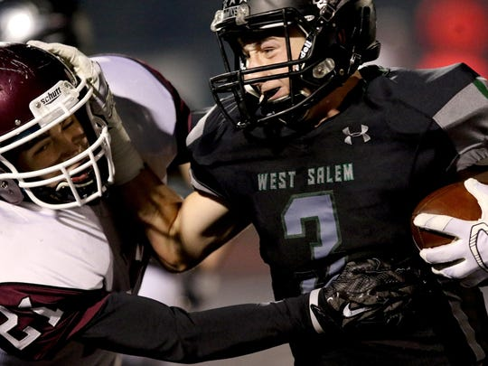 West Salem's Hunter Johnson (3) pushes through Franklin's Trevor O'Neill (21) in the second half of the Franklin vs. West Salem football game in the first round of the class 6A state playoffs at West Salem High School in Salem on Friday, Nov. 6, 2015. West Salem won the game 32-0.
