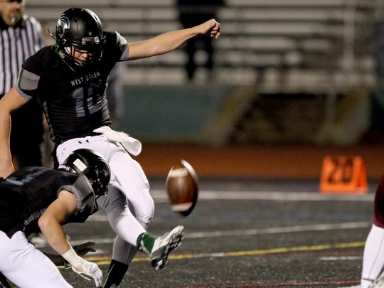 West Salem's Brody Wittman (10) kicks an extra point in the first half of the Franklin vs. West Salem football game in the first round of the class 6A state playoffs at West Salem High School in Salem on Friday, Nov. 6, 2015.
