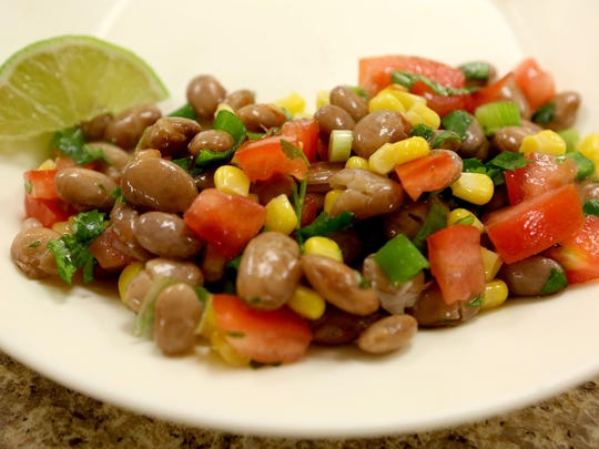 A cowboy bean salad is prepared by Tonya Johnson during a healthy cooking demonstration for CCTV.