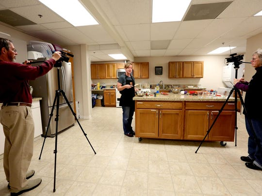 Tonya Johnson, center, a family community health instructor with the Oregon State University Extension Service, leads a healthy cooking demonstration as CCTV volunteers Paul Seesing, left, and Laurel Grove record it at the OSU Extension Office in Salem.