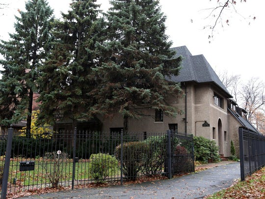 This historic Indian Village home in Detroit built in 1917 by architect Leonard B. Willeke; its original gardens were designed by Jens Jenson.