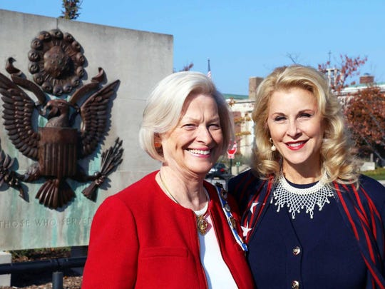 Barbara Suhay, a regent with the Piety Hill Chapter of the Daughters of the American Revolution, and Veterans Day soloist Bonnie Brooks of Auburn Hills.