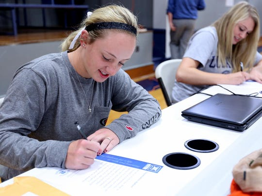 Maddie Hopper, left, signs a letter of intent to play softball with the University of the Pacific while Emma Gibb signs a letter of intent to play basketball at UC Davis at Western Mennonite High School in Salem on Wednesday, Nov. 11, 2015.
