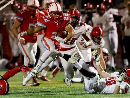 South Salem's Francisco Ramirez Perez (22) rushes with the ball in the Oregon City vs. South Salem class 6A playoffs football game at South Salem High School on Friday, Nov. 13, 2015.