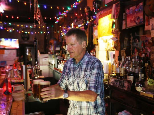 David Andrichik, proprietor of the Chatterbox Tavern, works the bar in 2014. The Chatterbox will host its annual Christmas sing-a-long event Dec. 15.