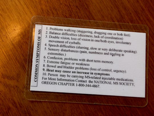A card listing common symptoms of multiple sclerosis, carried by Linda Brown Ayers, of Salem, with information about the patient, physician and emergency contact on the other side. Photographed at the IKE Box in Salem on Friday, Dec. 4, 2015.