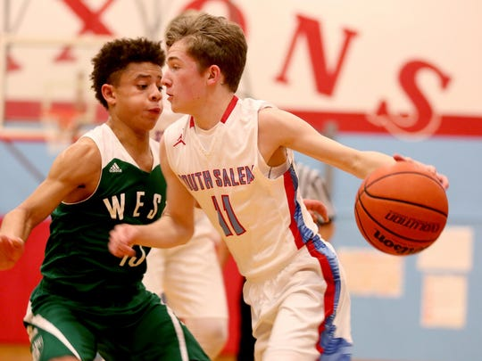 South Salem's Tyler Wadleigh (11) moves with the ball past West Salem's Isaiah Pineda (13) in the first half of the West Salem vs. South Salem boy's basketball game at South Salem High School on Tuesday.