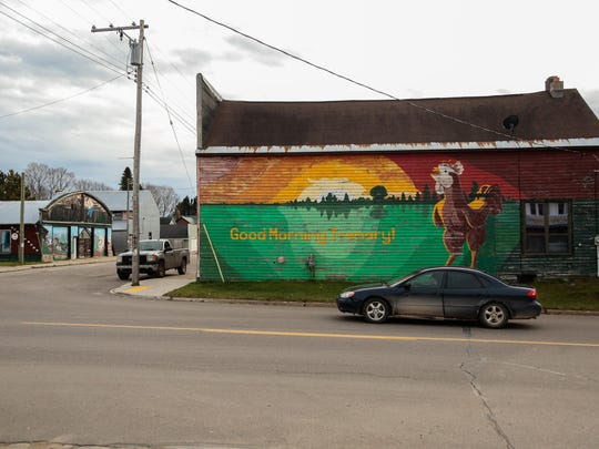 A vehicle makes it's way to a stop at Trenary Ave. and E.T. Rd. where a mural welcomes travelers to Trenary, MI in Michigan's Upper Peninsula on Tuesday November 17, 2015.