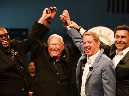 Ford and UAW leaders celebrate the start of bargaining in July. Auto industry employment should continue growing in 2016.