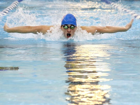 South Salem's Paul Lomax competes in the 100 yard butterfly in the West Salem vs. South Salem swim meet at the Kroc Community Center in Keizer on Tuesday, Jan. 5, 2016.