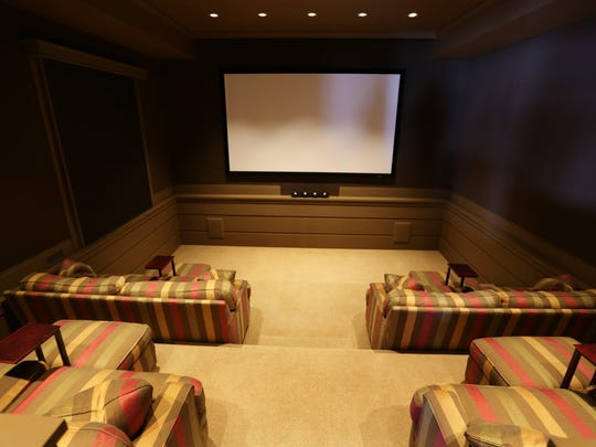 This home theater was created as part of renovations the current owner did. She put in high-end sound, along with four cushy sofas on risers.