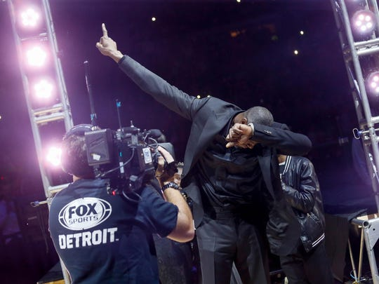 """Pistons great Ben Wallace """"dabs"""" during the halftime ceremony to retire his No. 3 on Saturday night at the Palace."""