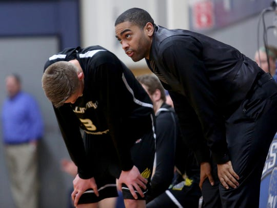 Columbia Christian head coach Vince Hicks talks to player Hunter Endresen (3) in the Columbia Christian vs. Western Mennonite boy's basketball game at Western Mennonite High School in Salem on Monday, Jan. 18, 2015.
