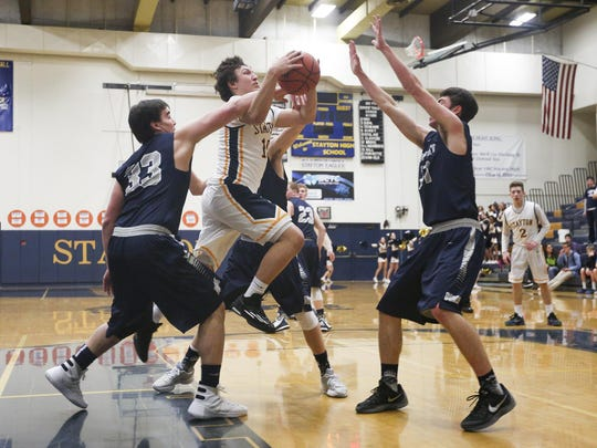 Stayton senior Everett St Clair (10) goes up for a basket against Newport at Stayton High School on Tuesday, Jan. 19, 2016. The Stayton Eagles lost 38-51 to the Newport Cubs.