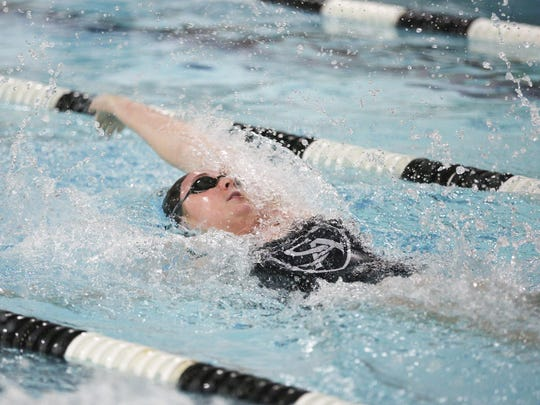 Salem Academy's Kiera Supple swims the women's 100 yard backstroke at a meet against Philomath High School in Philomath on Thursday, Jan. 28, 2016.