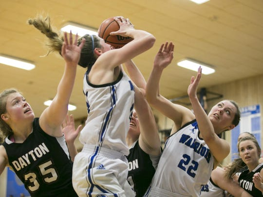 Amity senior Madelyn Krotzer comes down with the rebound in a game against Dayton at Amity High School on Friday, Jan. 29, 2016. Amity won 46-42 after a close game.