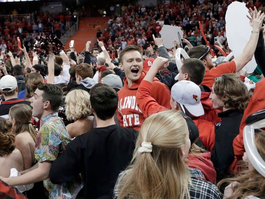 Illinois State fans storm the court after the team's NCAA college basketball game against Wichita State on Saturday, Feb. 6, 2016, in Normal, Ill. Illinois State won 58-53. (AP Photo/ Stephen Haas)