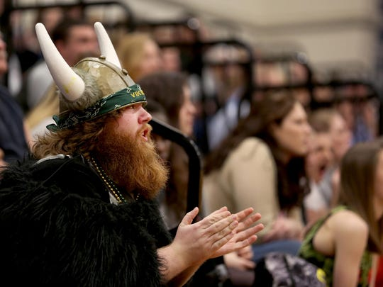 David Anderson cheers for the Colton Vikings in the Colton vs. Blanchet boy's basketball game at Blanchet Catholic School in Salem on Tuesday, Feb. 9, 2016.