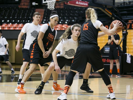 Oregon State senior Jamie Weisner (15) scrimmages against Oregon State student Derek Saling at a practice on Thursday, Feb. 10, 2016. Saling is a member of Tune Squad, a small group of male OSU students who practice with the women's basketball team roughly two to three times a week.