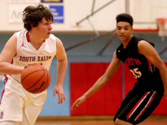 South Salem's Damian Moe (10) moves past North Salem's Jordan Sampson (35) in the North Salem vs. South Salem boy's basketball game at South Salem High School on Tuesday, Feb. 16, 2016. South Salem won the game 82-36, clinching the Greater Valley Conference Championship.