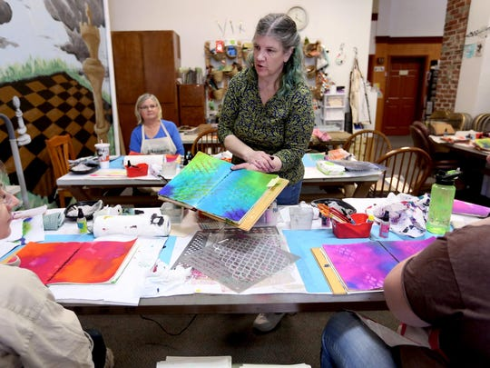 Christy Wood leads a class on creating art journals at the Runaway Art and Craft Studio in downtown Salem.