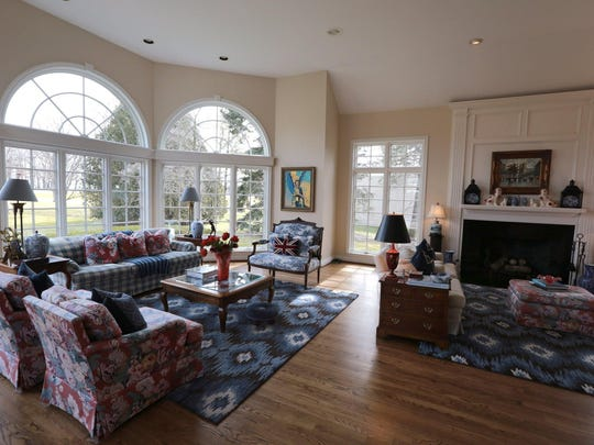 The family room is similar to the master bedroom, but it's 34 feet long. The original room ends near the fireplace.