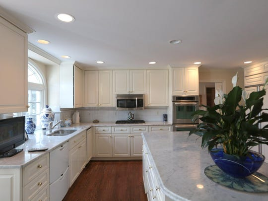 The kitchen was also part of the 1992 addition. It's 20-by-17 feet with white cabinets, oak floors and white marble countertops. A double sink faces the golf course, and there are double ovens and double dishwashing drawers.