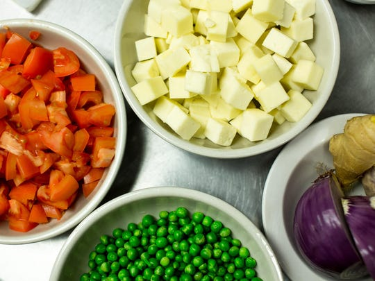 Diced tomatoes, Paneer cheese, ginger, garlic, red onions, and peas make up the essential elements of Matar Paneer, a Northern Indian Staple that chef Theo Smith considers his litmus test for other Indian Restaurants.