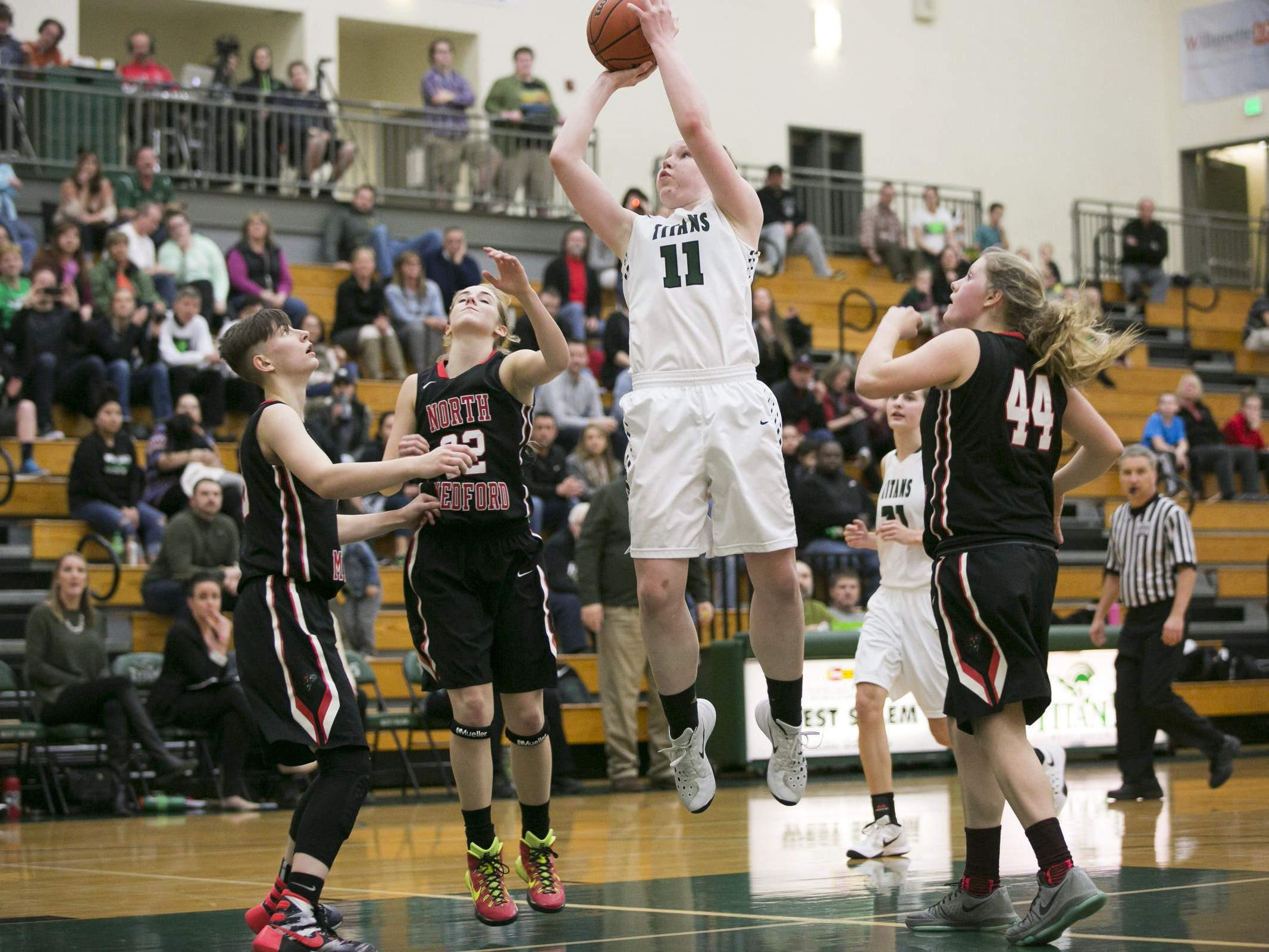 West Salem junior Delaney Henery goes up for a basket in a game against North Medford at West Salem High School on Tuesday, March 1, 2016. West Salem won the OSAA round one playoff game 58-55 in overtime.