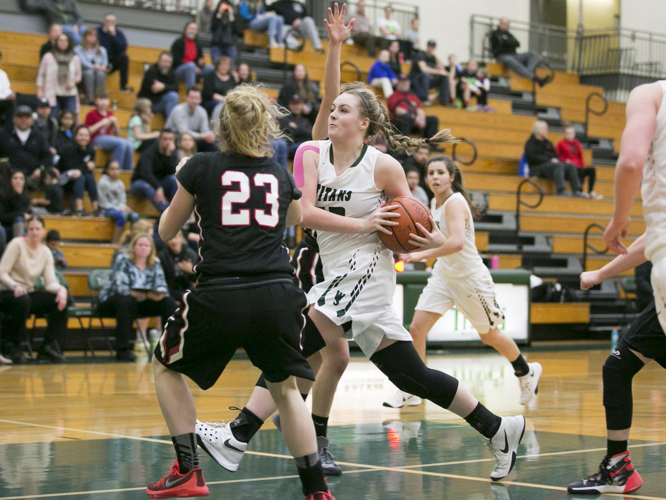 West Salem sophomore Brenna Redman drives towards the basket in a game against North Medford at West Salem High School on Tuesday, March 1, 2016. West Salem won the OSAA round one playoff game 58-55 in overtime.