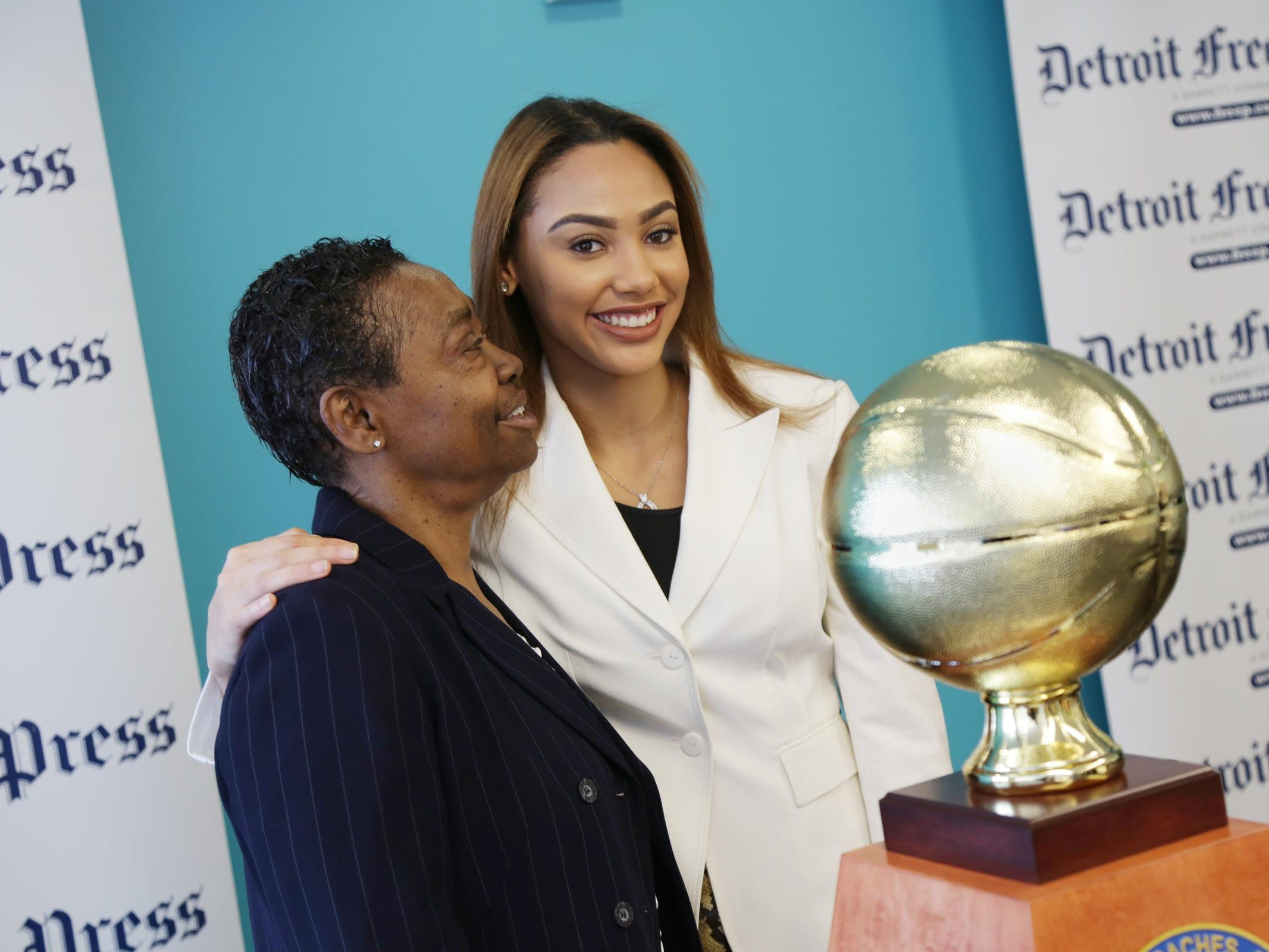 Miss Basketball 2016 Kysre Gondrezick brings her grandmother, Ruth Harvey, into the picture with the trophy.