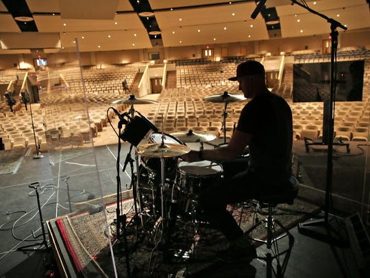Drummer Landon Rose readies his drums for the next Sunday's services at Traders Point Christian Church, Monday, March 21, 2016.