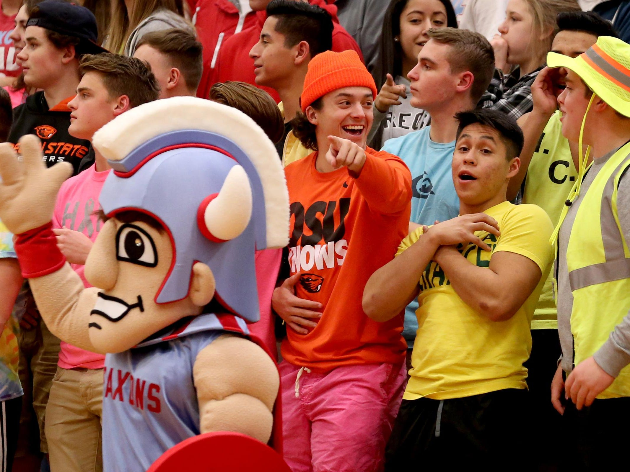 South Salem fans celebrate a play in the McNary vs. South Salem boy's basketball game at South Salem High School on Tuesday, Feb. 2, 2016. South Salem won the game 53-52.