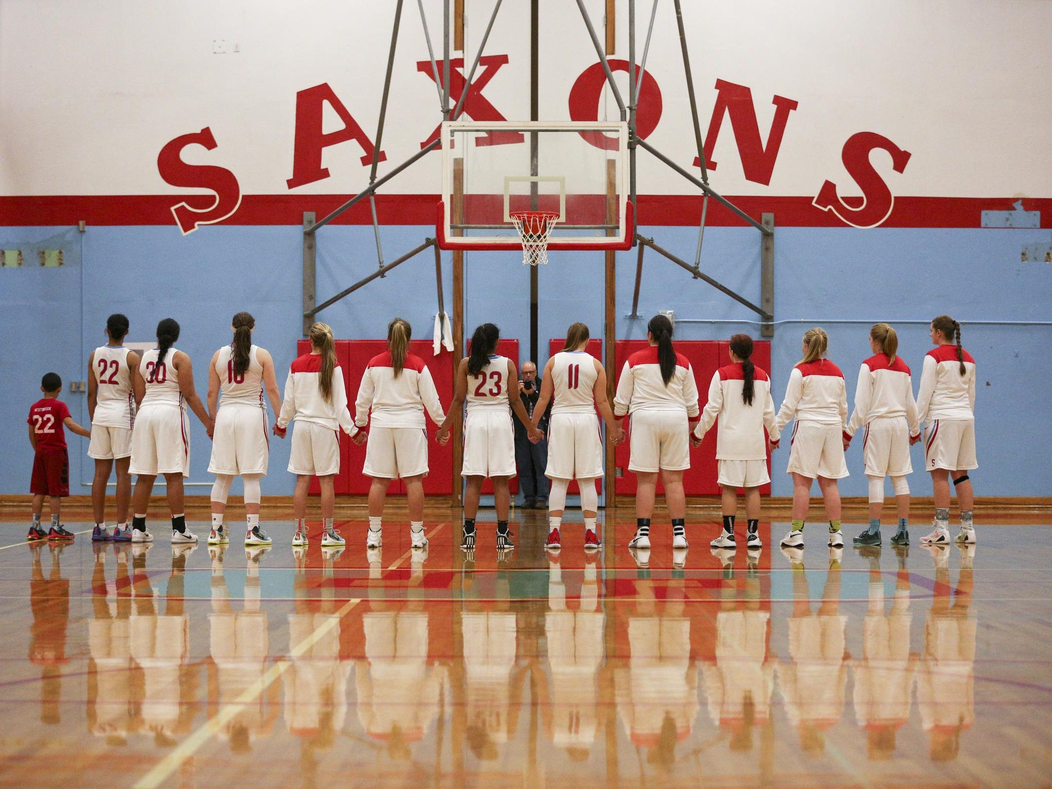 South Salem girls basketball stands together for the national anthem before they face the McMinnville Grizzlies in Salem on Friday, Jan. 8, 2016.