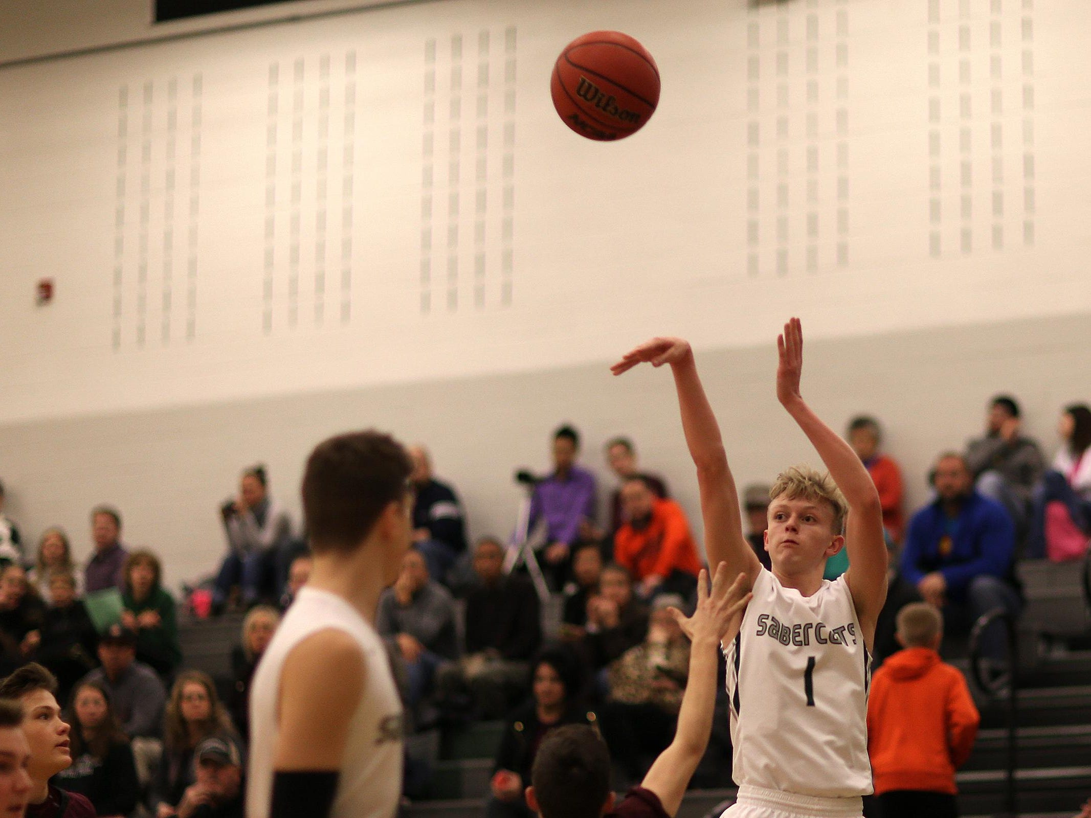Fossil Ridge's Braxton Bertolette is one of 10 players named to the Coloradoan's All-Area basketball teams.