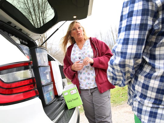 Nurse Jackie McClintock of the Scott County Health Department talks with a drug user from the Mobile Needle Exchange unit. The project provides supplies to users who don't get to the clinic.