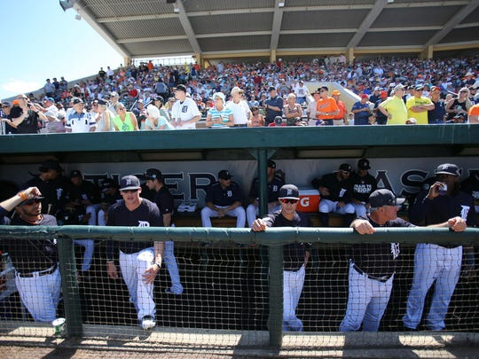 Tigers players hang out in the dugout against the Pittsburgh Pirates at Joker Marchant Stadium in Lakeland, Fla. The season opens tonight in Miami.