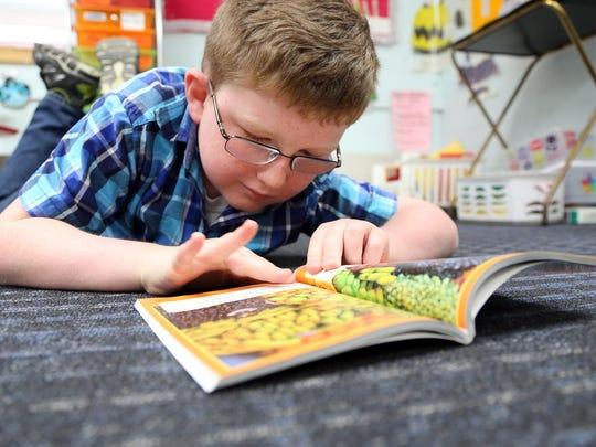 Thomas Kramer practicing his reading skills.