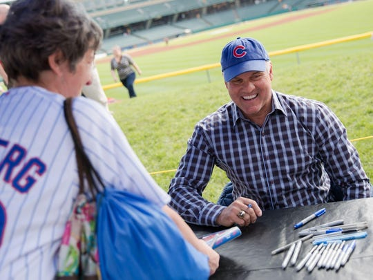 Former Cubs star Ryne Sandberg signs autographs at Saturday's Indianapolis Indians game at Victory Field.