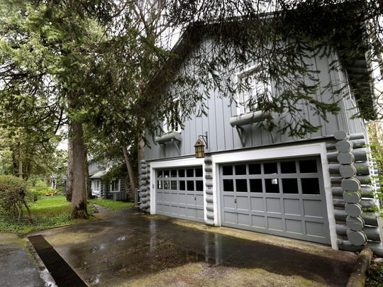 No chauffeur? No problem. This garage can shelter cars and in a carriage house, guests.