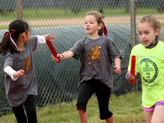 Second grade girls race during the 42nd annual Country Kids Relays at McCulloch Stadium at Bush's Pasture Park in Salem on Saturday, May 21, 2016.