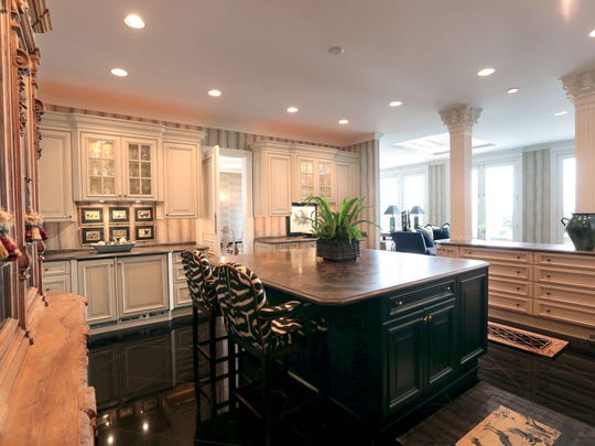This is the show kitchen, open to the living and dining areas. It has everything that a host might need to entertain guests. The working kitchen, where cooking is done, is elsewhere.