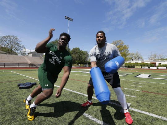 Michael Dwumfour, left, and Rashan Gary work out in New Jersey in 2016.