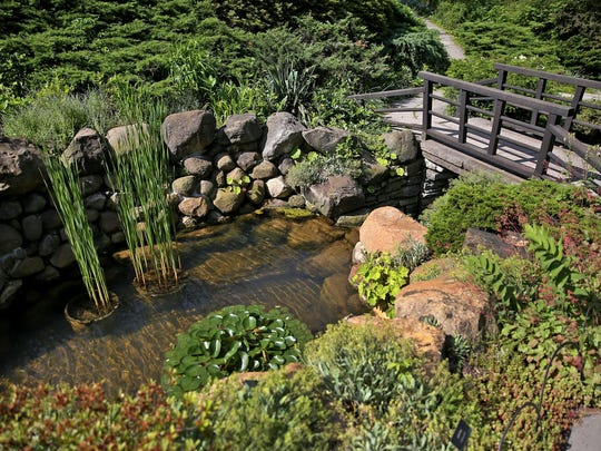 Many walking paths offer beautiful vistas, like this one, the Rapp Ravine Garden, in the Indianapolis Museum of Art's gardens.