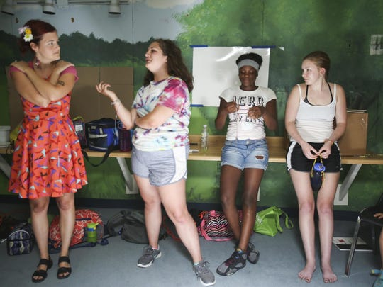 Megan Hart, Maddie Brooks, Jasmine Lee, and Molly Denning play the question game during Climate Camp at the Peace Learning Center at Eagle Creek Park on July 25, 2016.