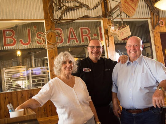 The Rathmann family — Roberta and Peter Rathmann with their son Jay — take a moment at their BJ's Barbecue on Victorian Avenue in Sparks. The restaurant began as a small, barbecue-only storefront in 1986 about a mile away on North McCarran Boulevard.